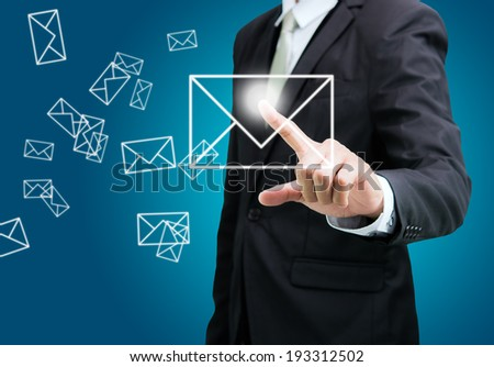 Businessman standing posture hand touch mail icon isolated on over blue background - stock photo