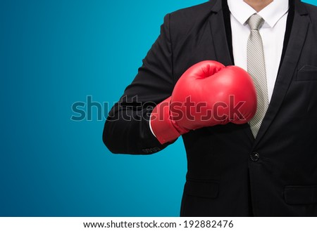 Businessman standing posture in boxing gloves isolated on over blue background