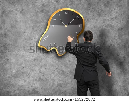 Businessman standing - time strategy concept incolor - stock photo