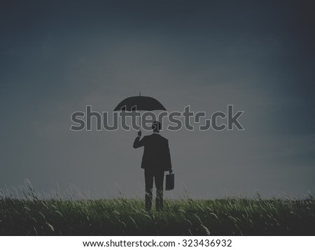 Businessman Standing Umbrella Grass Concept - stock photo