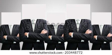 Businessman standing white paper face holding front of head on over gray background