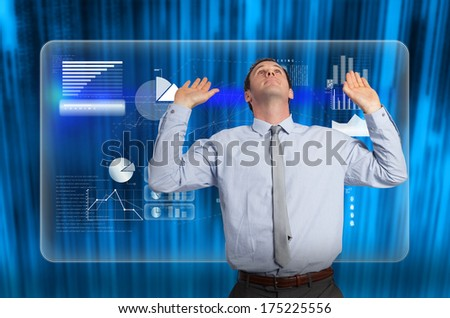 Businessman standing with arms pressing up against futuristic blue black background