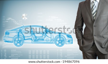 Businessman standing with hands in pockets. On background of the high-tech wire frame car and graphs - stock photo