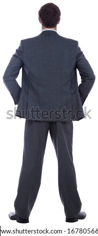 Businessman standing with hands on hips on white background