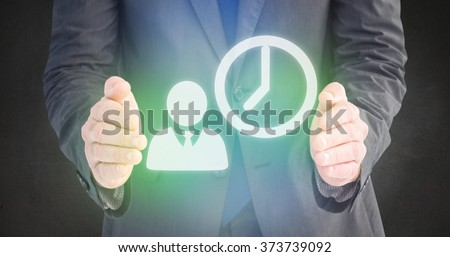Businessman standing with hands out against grey room - stock photo
