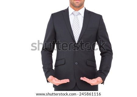 Businessman standing with hands out on white background - stock photo