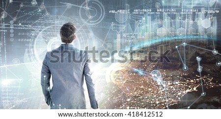 Businessman standing with his briefcase against image of a earth - stock photo