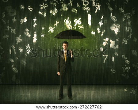 Businessman standing with umbrella and 3d numbers raining concept on background - stock photo