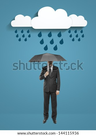 businessman standing with umbrella under clouds on blue background
