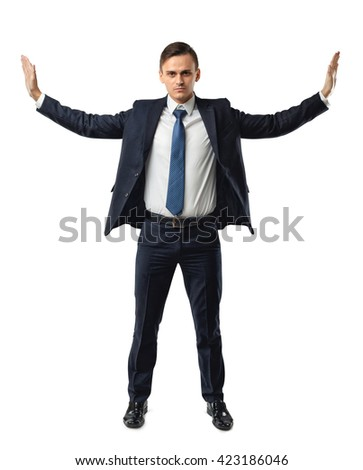 Businessman stands pushing invisible walls by his hands. Cutout portrait. Faith in his own strength. Business staff. To push the boundaries of the possible. Office clothes. Believe in yourself.  Dress