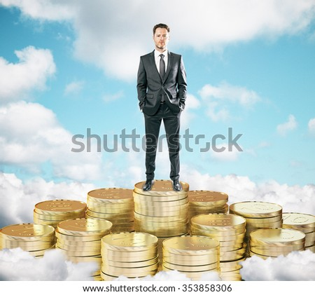 Businessman staying on pile of gold coins on the clouds t blue sky background