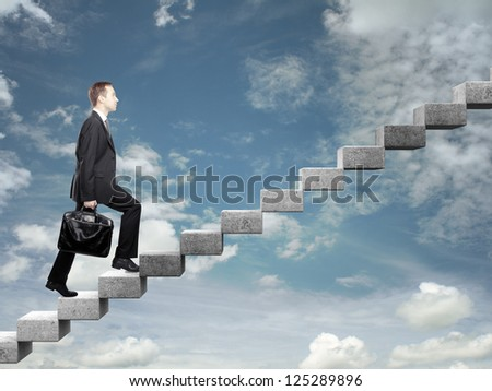 Businessman stepping up a staircase and sky - stock photo