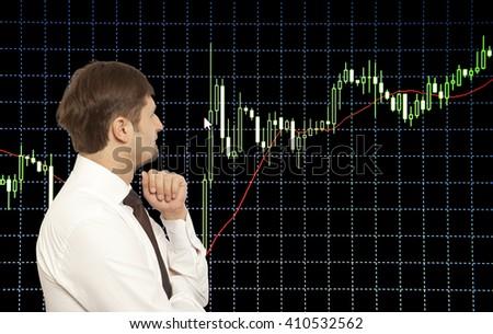 Businessman stock trader looking at monitors - stock photo