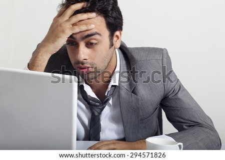 Businessman stressed at work - stock photo