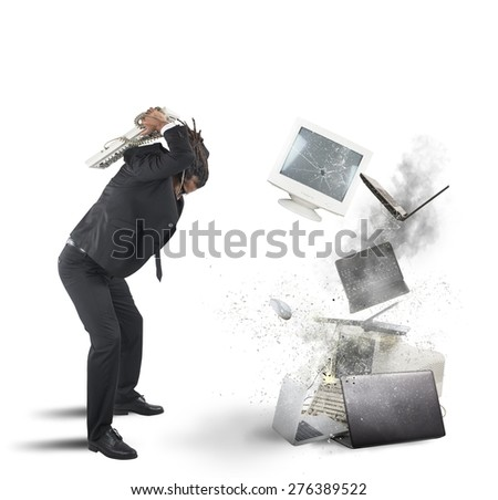Businessman stressed out from work breaks computers - stock photo