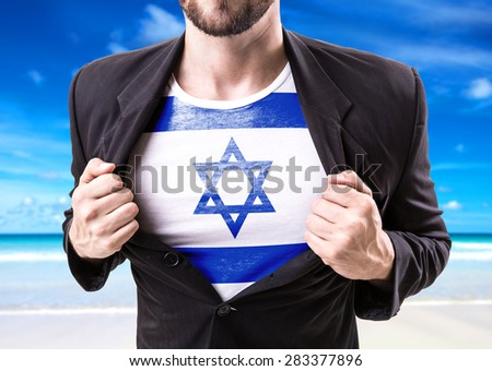 Businessman stretching suit with Israel on beach background - stock photo