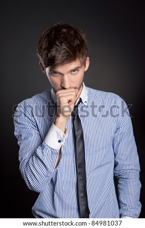 businessman suffer from a bad cough over black background - stock photo