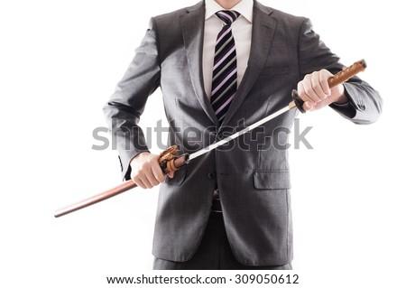 Businessman suit that has a Japanese sword - stock photo