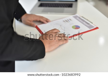 Businessman, supervisor Checking work or reporting work. To sign, receive and approve