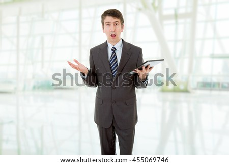 businessman surprised and waiting with a tablet pc, at the office - stock photo