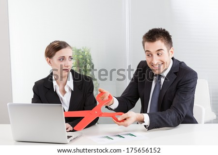 Businessman Takes Big Pair of Red Scissors Snip - stock photo