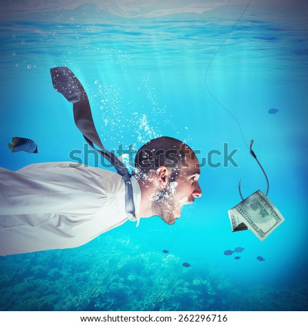 Businessman takes the bait to the hook - stock photo