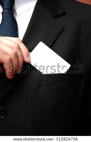 Businessman taking a blank business card out of his pocket