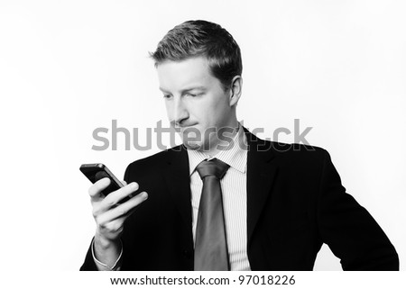 businessman taking a call and he's looks like he not sure about something