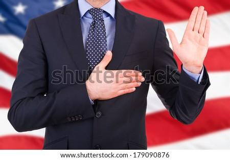 Businessman taking oath. - stock photo