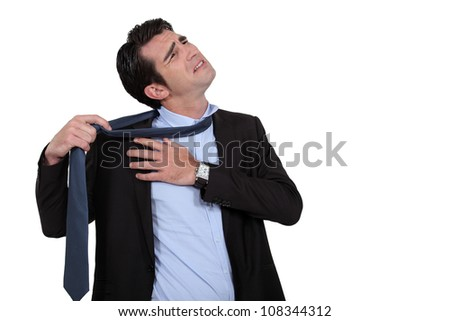 businessman taking off his tie - stock photo