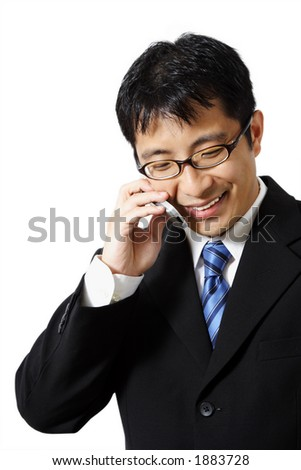 Businessman talking on a cell phone - stock photo
