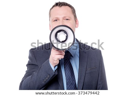 Businessman talking on a megaphone over white