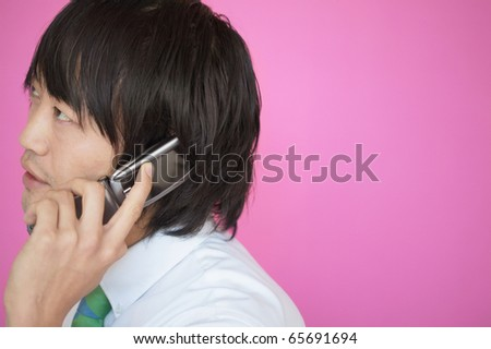 Businessman talking on a mobile phone - stock photo