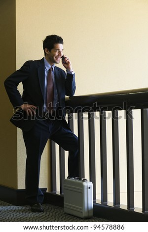 Businessman talking on cell phone - stock photo