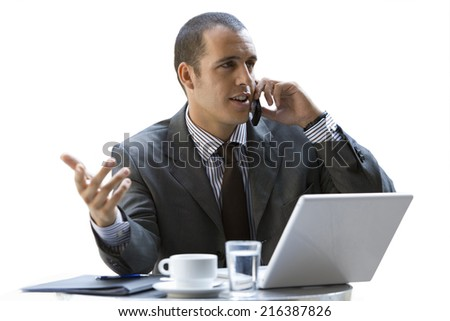 Businessman talking on cell phone, cut out