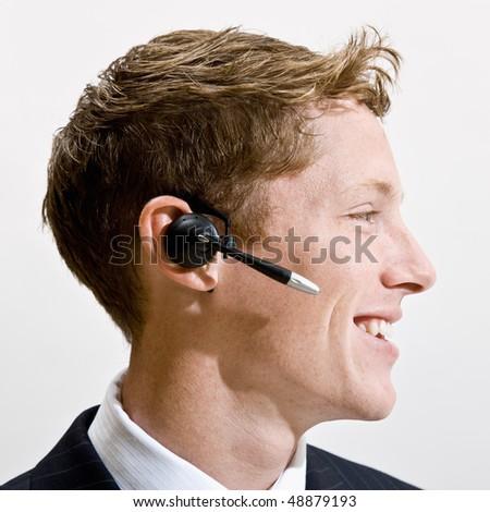 Businessman talking on headset - stock photo