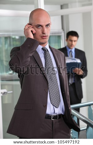 Businessman talking on his mobile phone - stock photo
