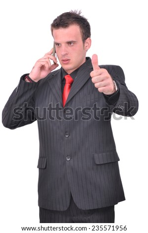 Businessman talking on his smartphone and holding thumbs up