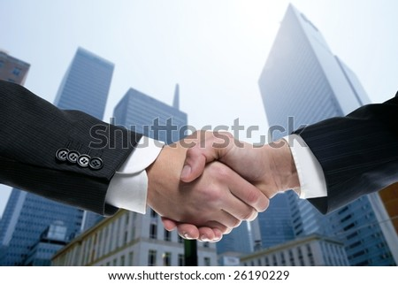 Businessman teamwork partners shaking hands with suit [Photo Illustration] - stock photo