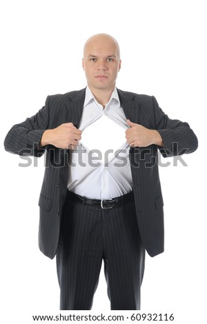 businessman tears open his shirt. Isolated on white