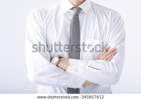 Businessman that his arms folded - stock photo