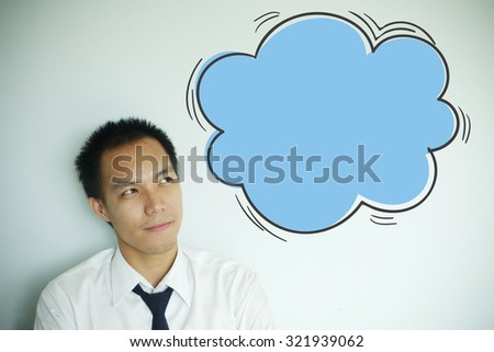Businessman thinking about a new idea on blue bubble , business idea concept - stock photo