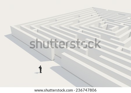 Businessman thinking about entering the maze. - stock photo