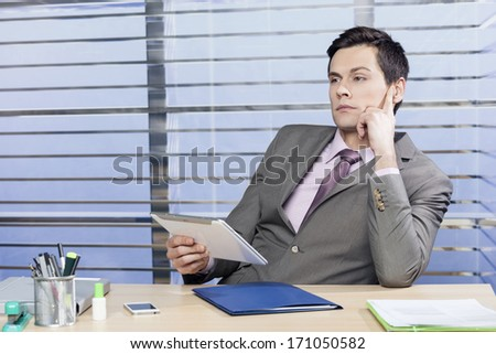 Businessman thinking about the problem - stock photo
