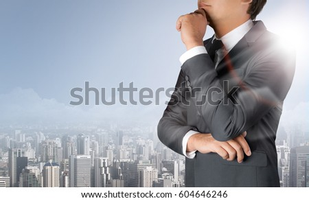 Businessman thinking and city concept