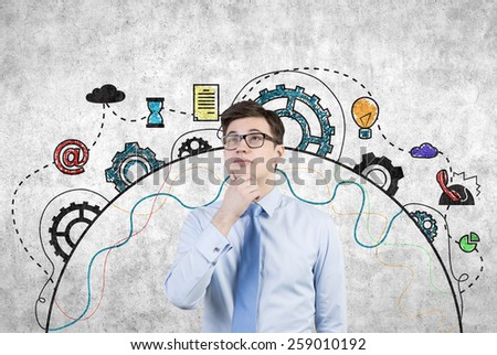 businessman thinking and drawing business icons on wall - stock photo