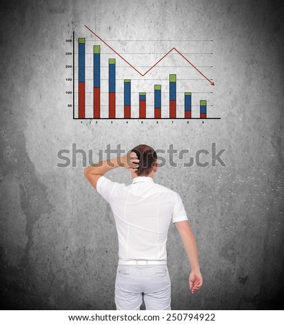 businessman thinking and looking to falling chart on wall - stock photo