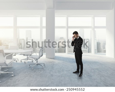 Businessman thinking in white office concept - stock photo
