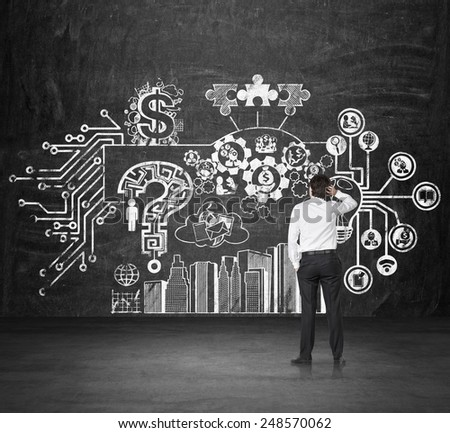 businessman thinking looking on drawing business strategy on wall - stock photo