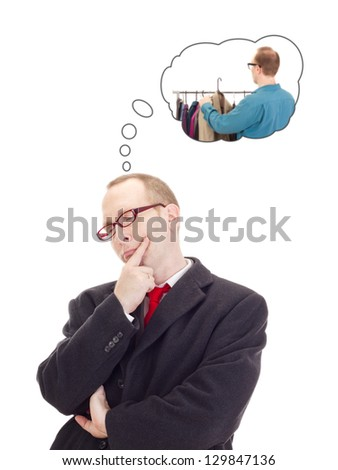 Businessman thinking of buying a new jacket - stock photo